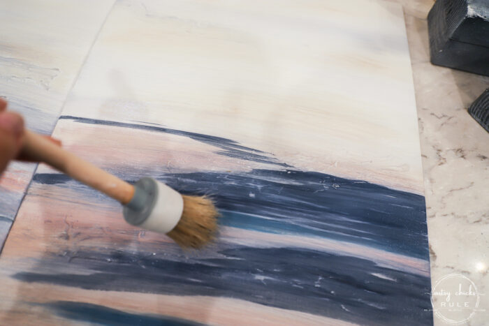 showing how to blend the paints colors with a bristle brush