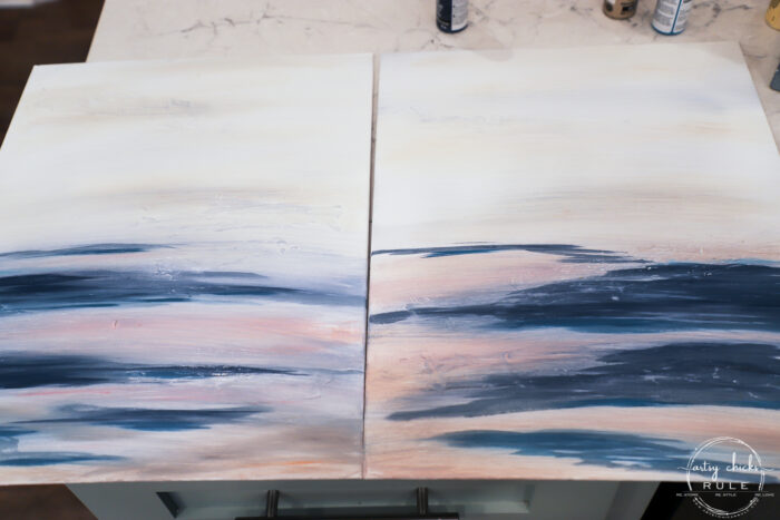 Both canvases with with paint that has been blended