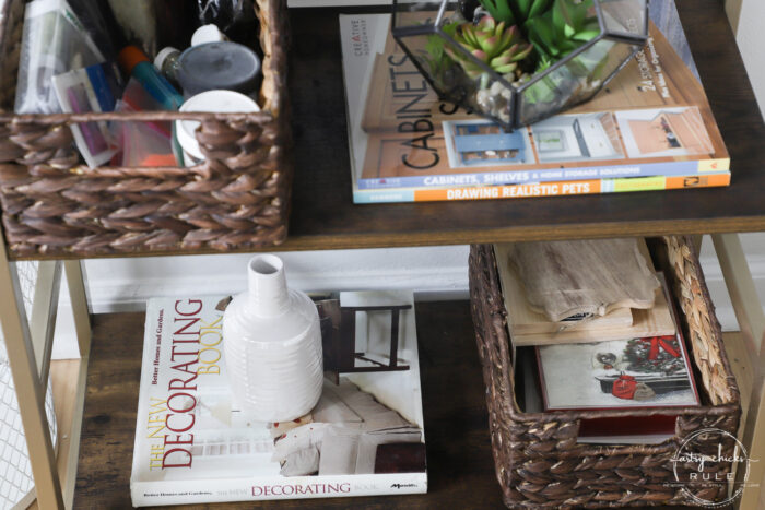bookshelf with books and baskets