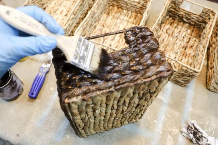 brushing on gel stain onto basket