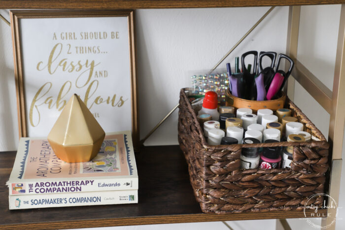 gold decor with books and craft paint basket