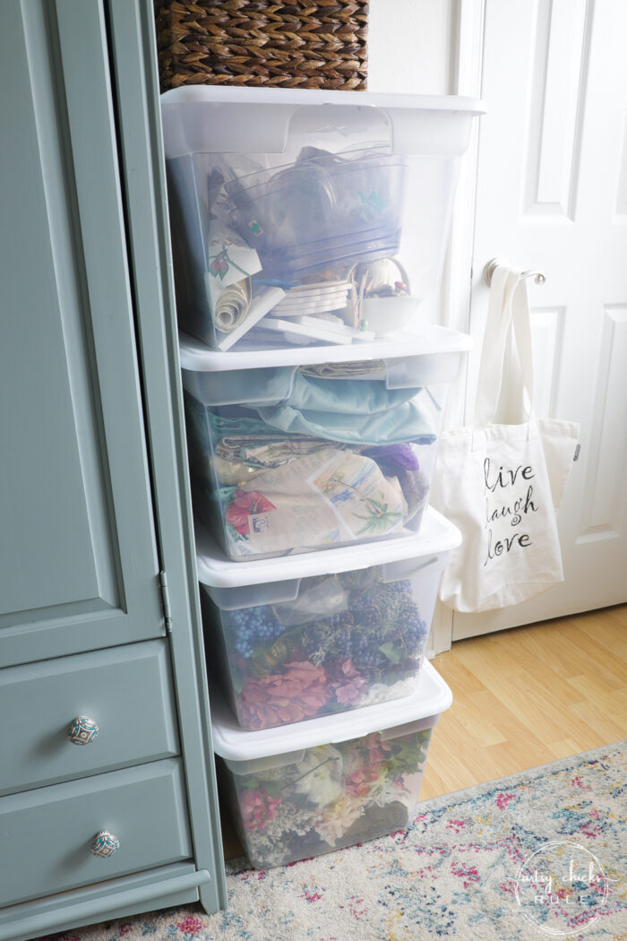 plastic bins with fabric and florals