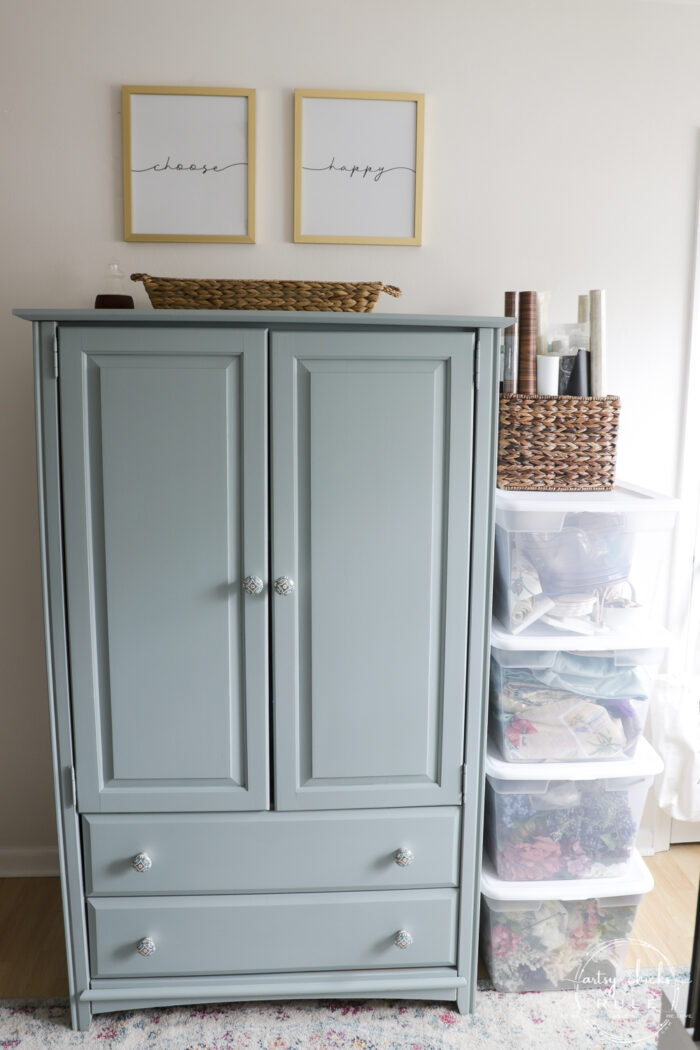 blue armoire with choose happy signs