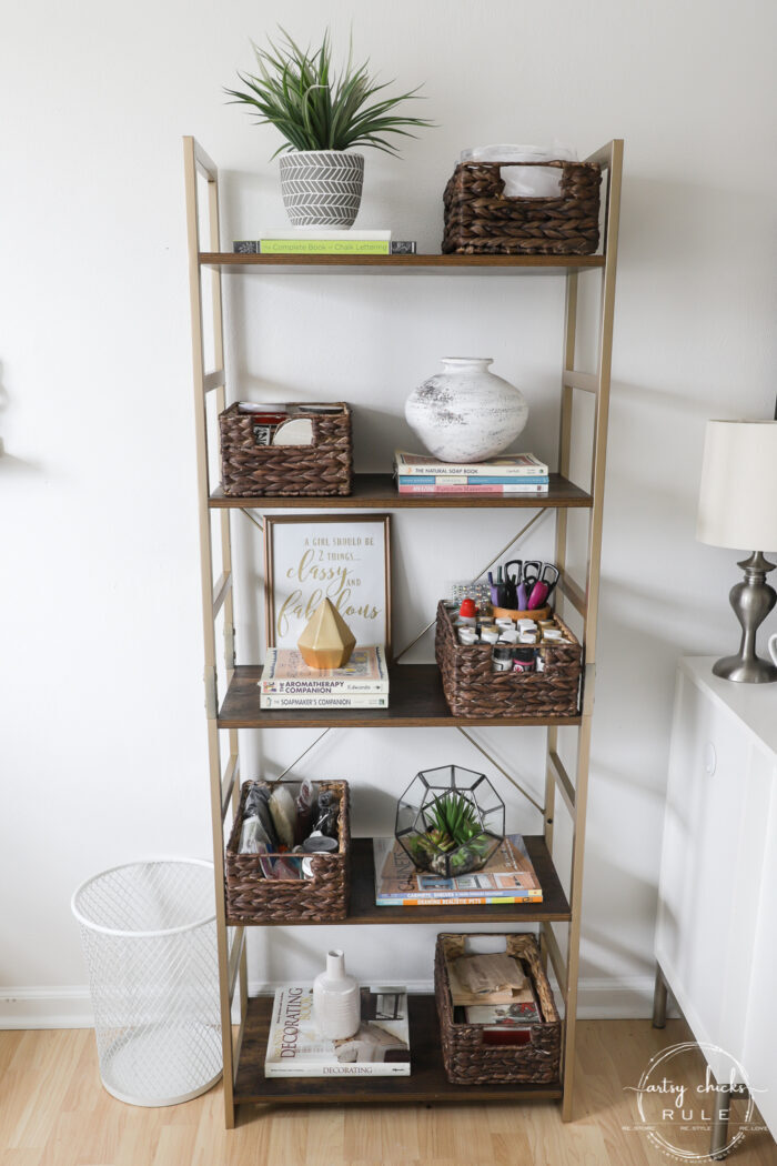 bookcase with baskets and books