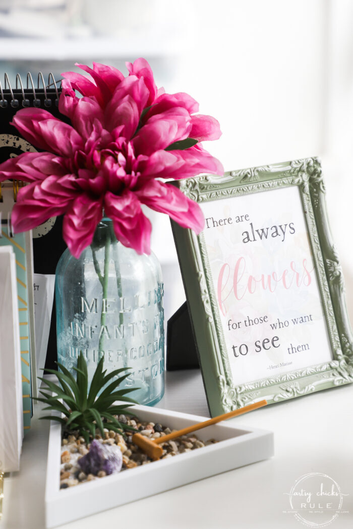 pink flower and spring sign