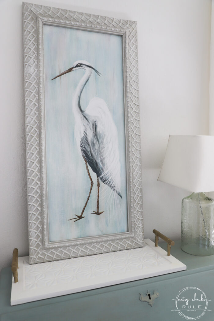 blue heron painting on desk with lamp