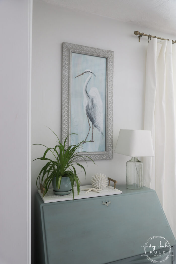 blue heron painting on wall