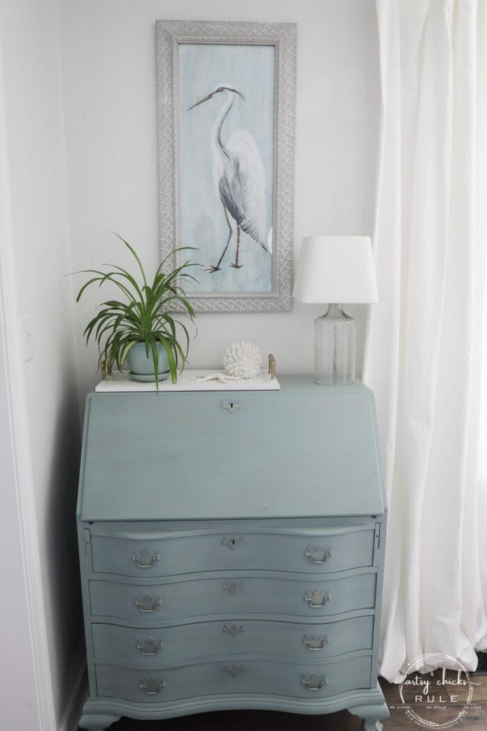 blue heron framed on blue secretary