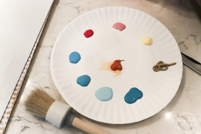 multi color acrylic paint on plate