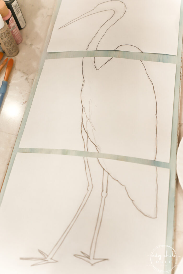 laying out drawing on painted background to transfer