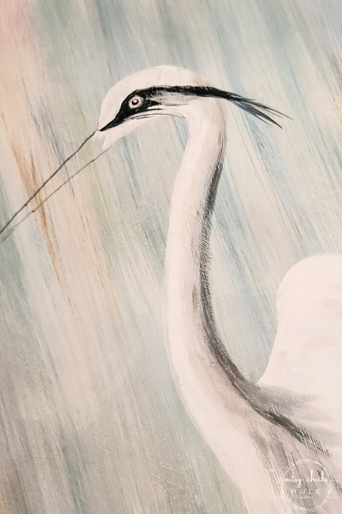 second step of painting in eye of blue heron