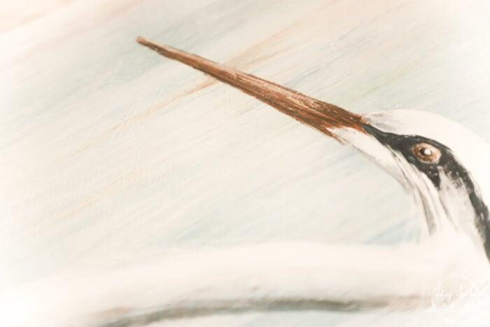 painted in blue heron beak