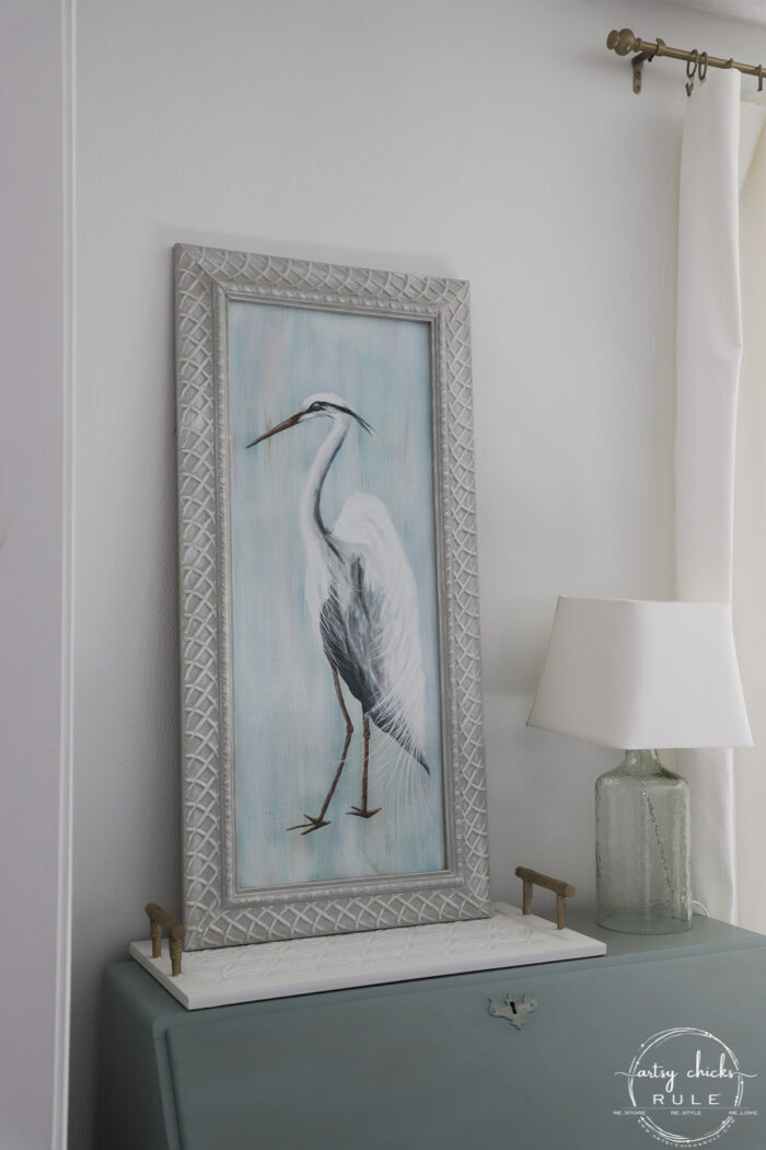 sideways view of blue heron on blue desk