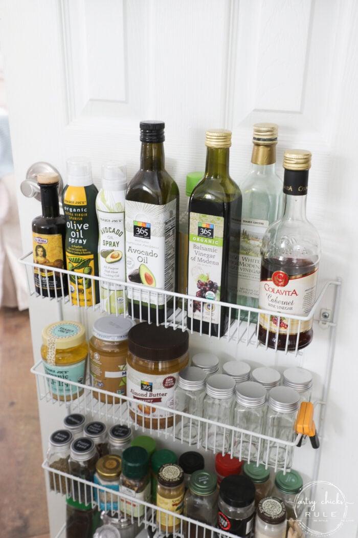 pantry door shelf with vinegar bottles and oils