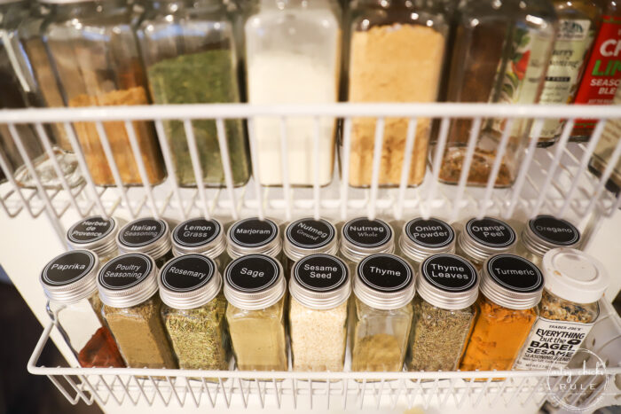 shelves on pantry door with spice bottles