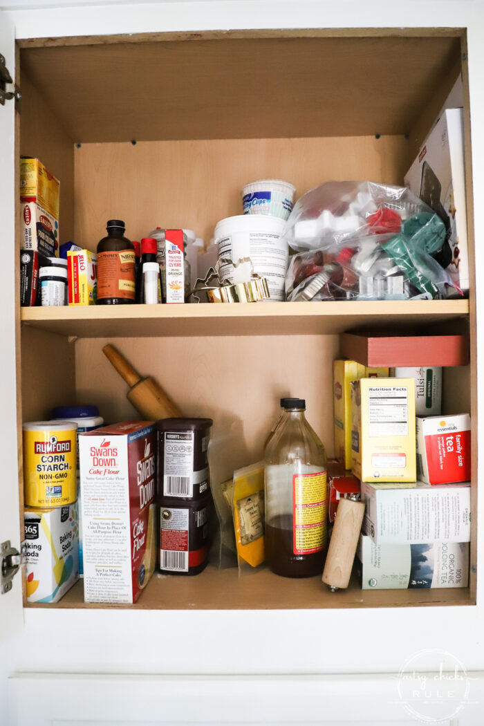 baking cabinet with cookie making items