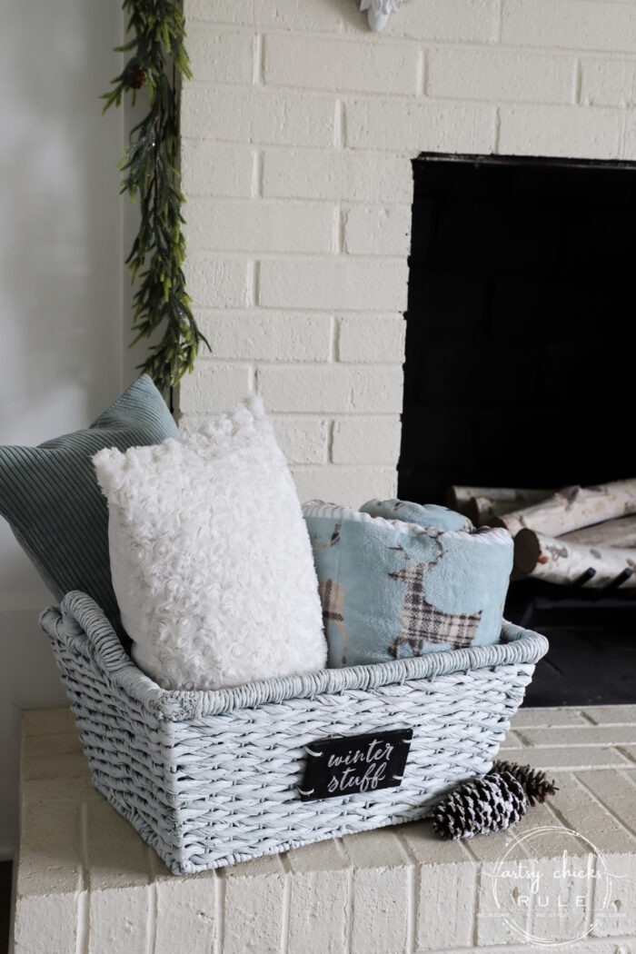 Winter white basket filled with blankets and pillows