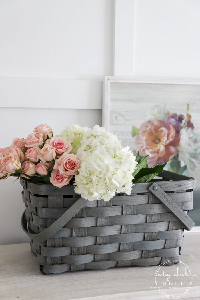 Sheer green stained basket filled with spring flowers