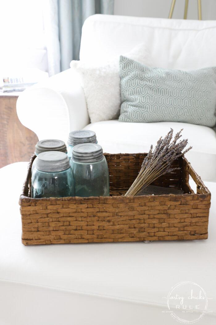 Rectangular basket filled with blue mason jars and lavender