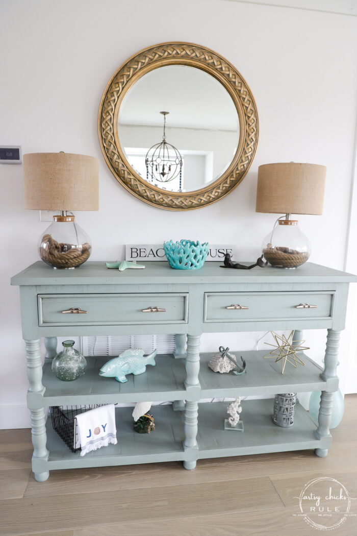 another finish picture of aqua console with gold mirror and decor