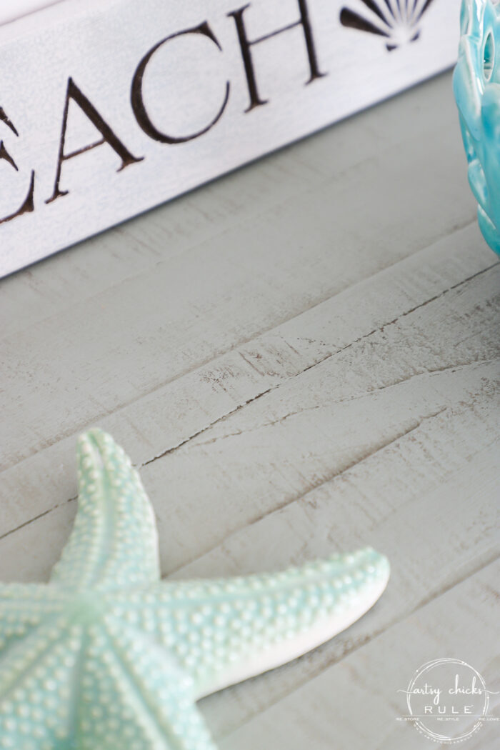 starfish on top of the aqua console with driftwood stained areas prominent