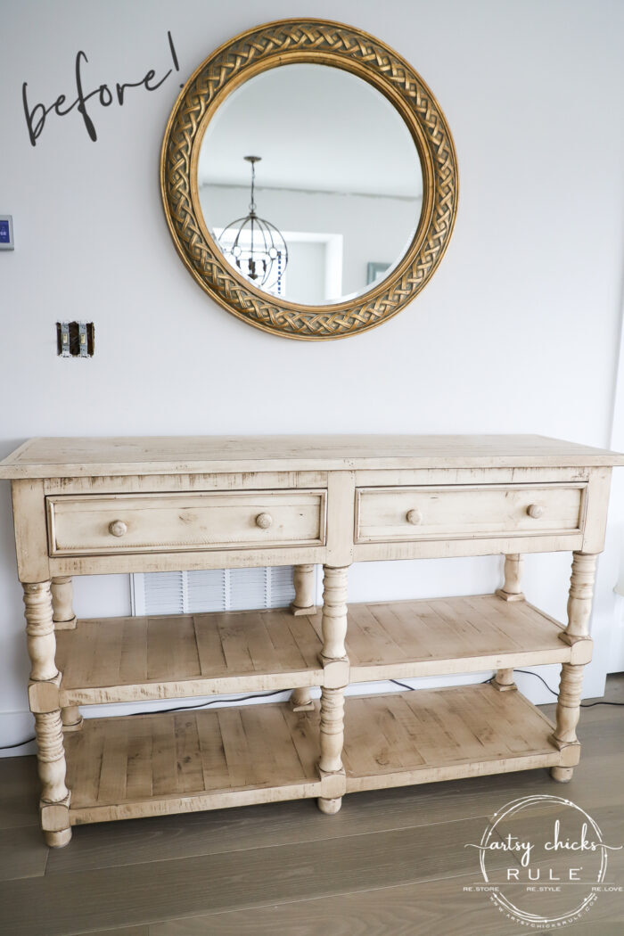 yellow console table round mirror on wall