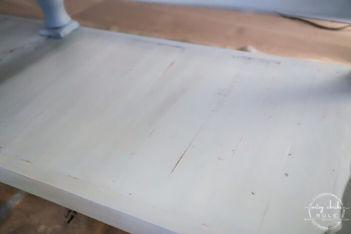showing the left side with stain, the right side without