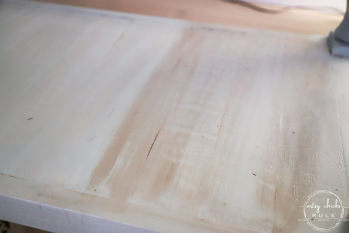 showing how to apply stain