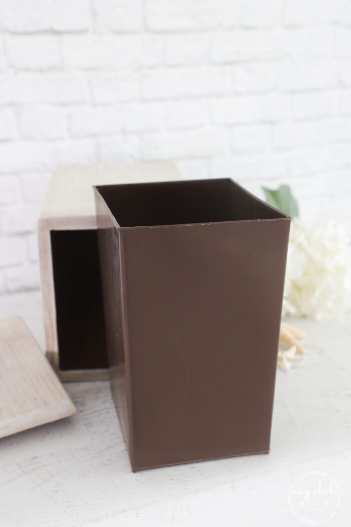 brown plastic insert outside of the wood box