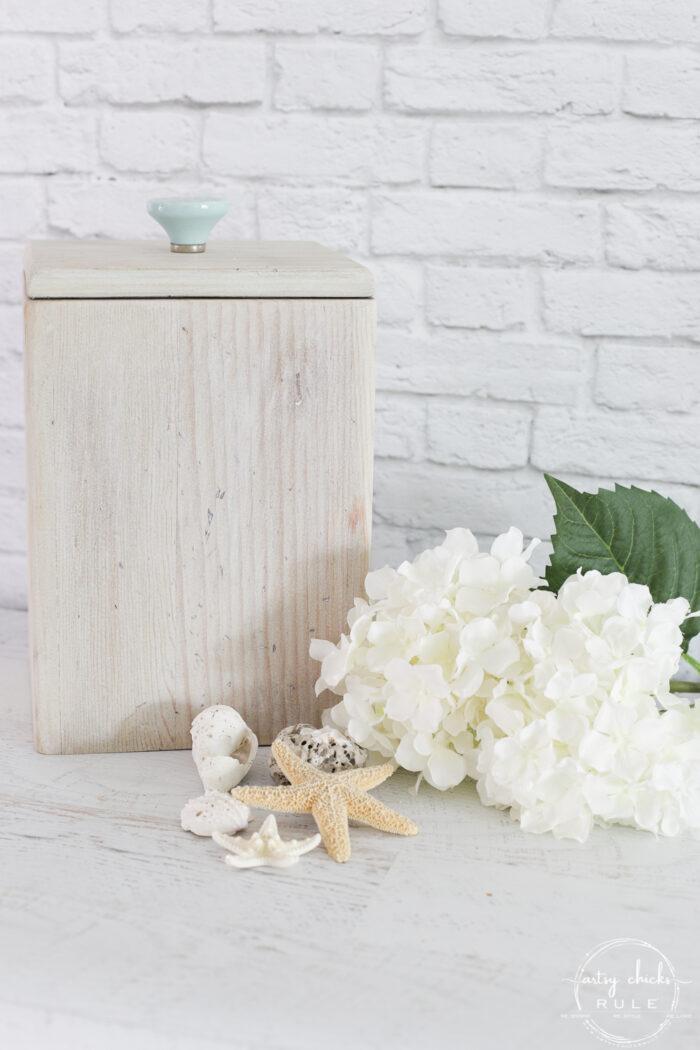 whitewashed wood box with aqua handle and white hydrangeas
