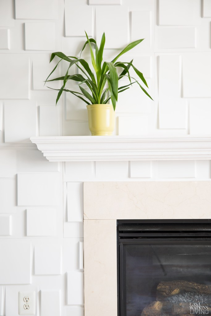 modern 3D blocks in white around fireplace with green plant on mantel