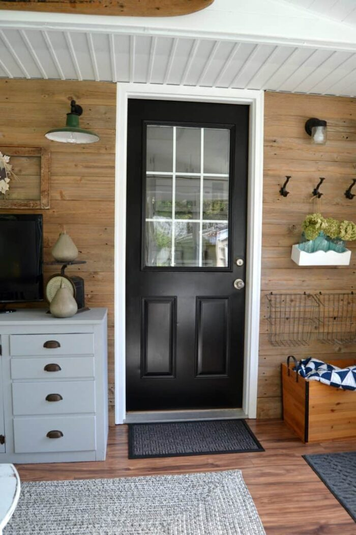 wood wall with reclaimed wood and black door