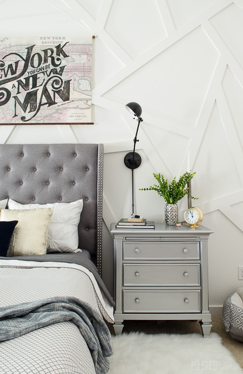 modern bedroom with white abstract wood wall and silver nightstand