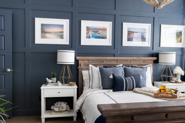 dark navy blue wall with board and batten boxes and bed, nightstands