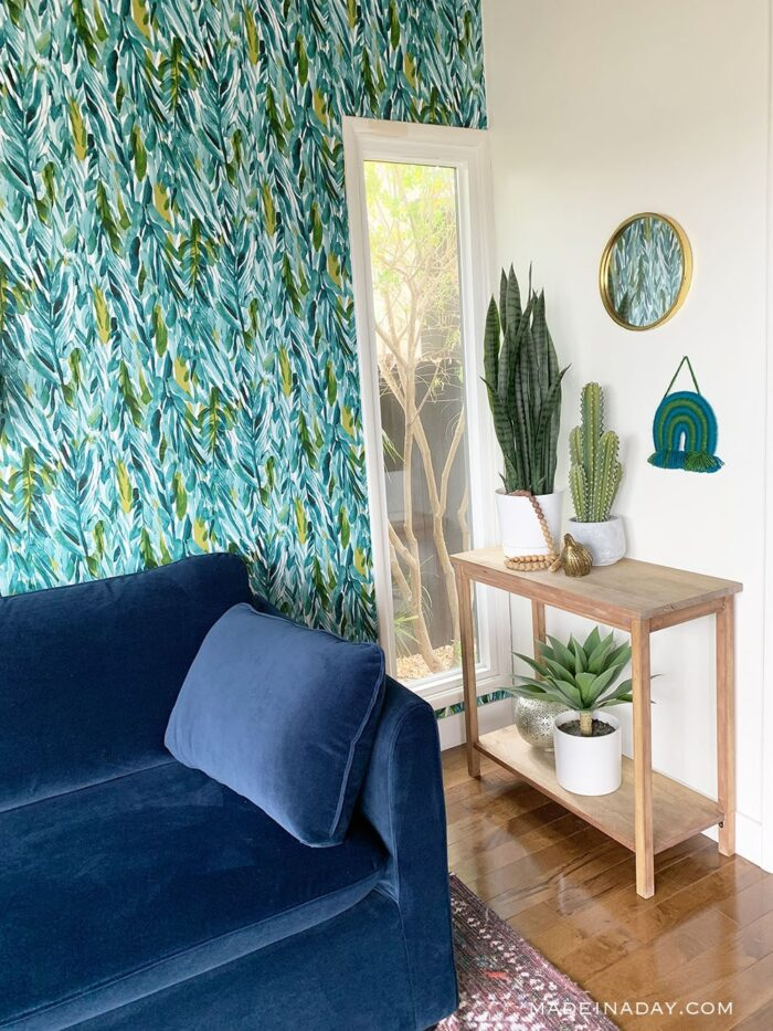 green and blue bold wallpaper wall blue couch