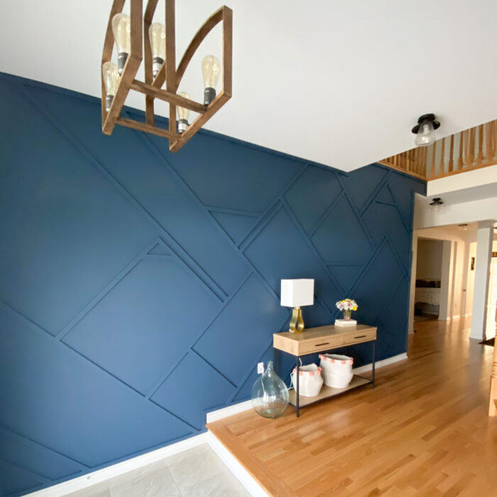 dark navy blue wall with abstract wood pattern on wall, wood floor