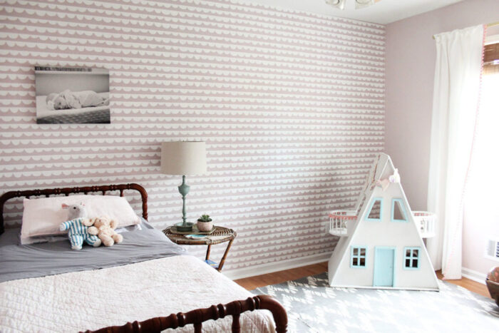 soft pink and white lined wallpaper girl's room