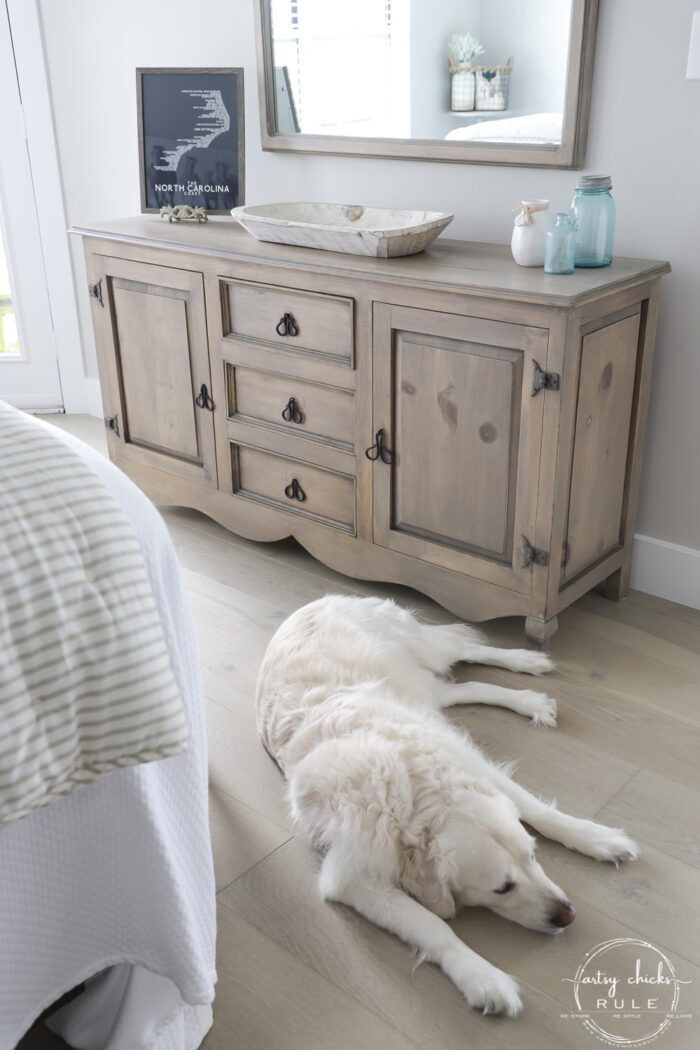driftwood dresser stained with white dog sleeping