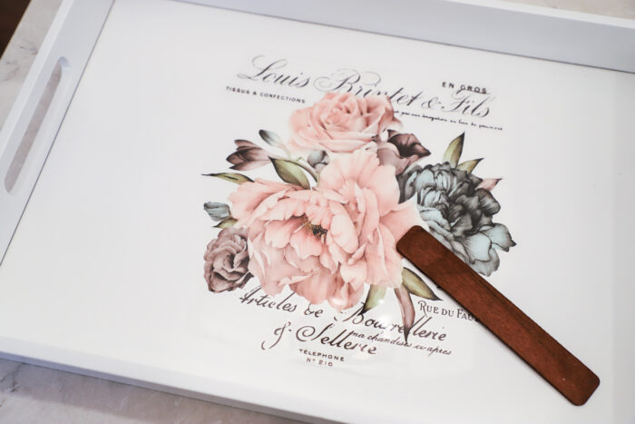 white tray with rose transfer being transferred