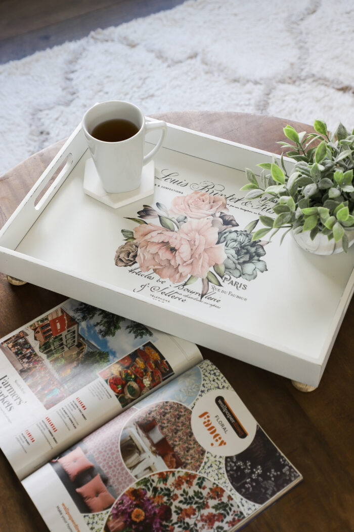 white tray with pink decal, tea and magazine
