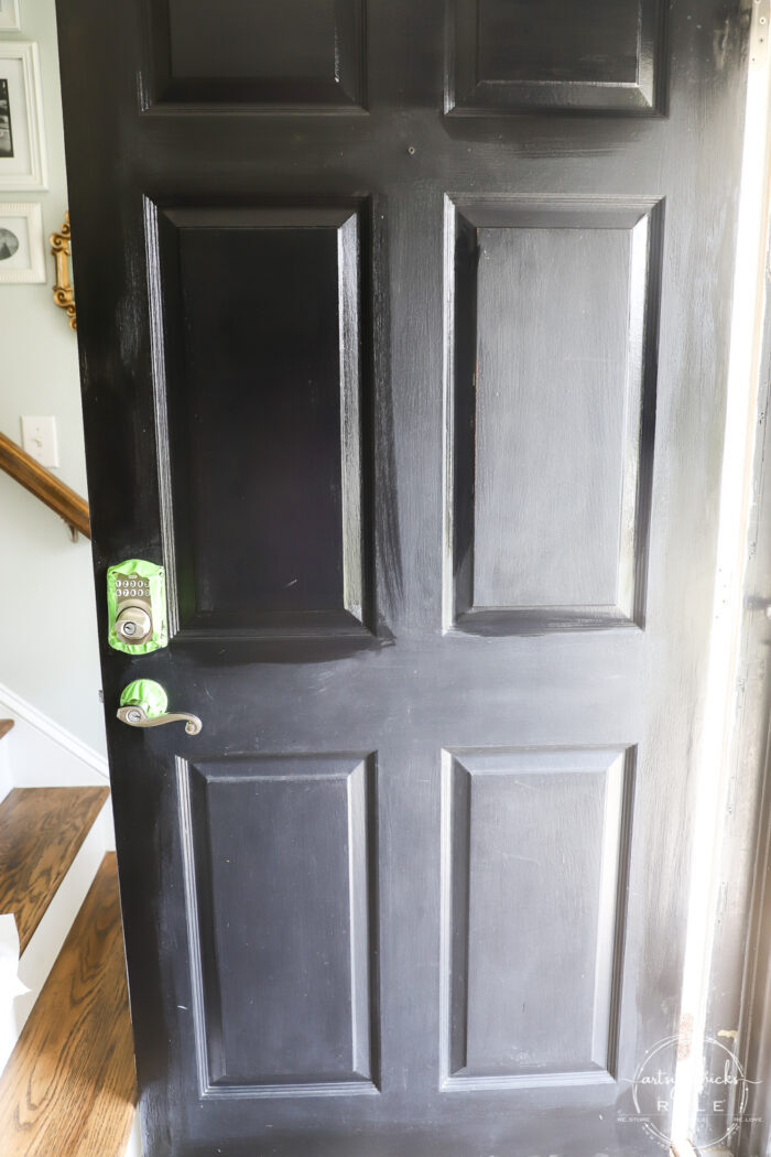 full black door with paint in the box