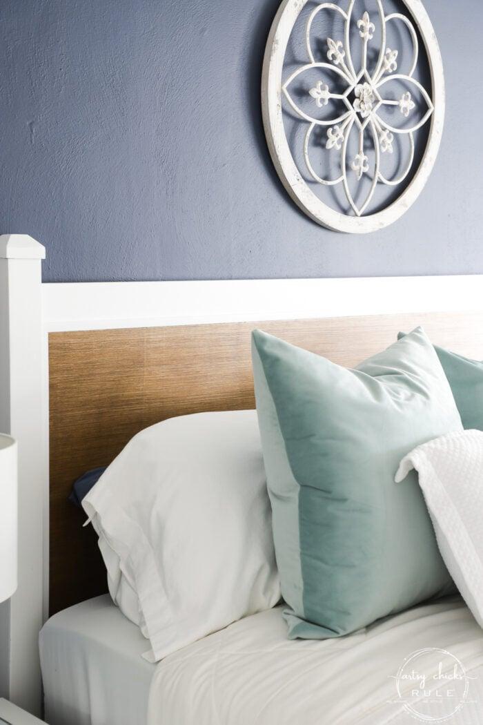 white pillows, aqua pillow and wood headboard