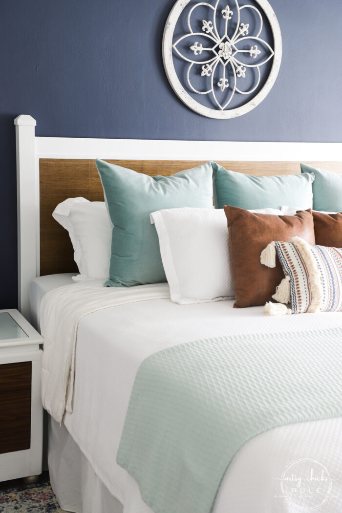 side of bed view with pillows and new headboard