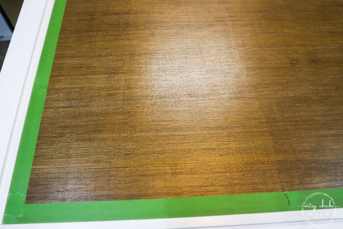 taped wood panel