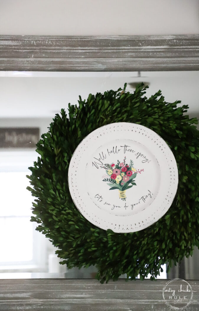 spring painted sign in the middle of a boxwood wreath