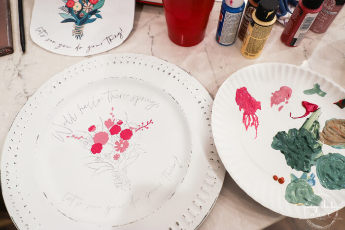 painting in the pink flowers on white plate