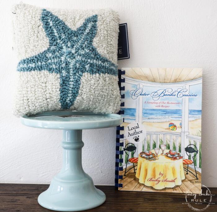blue and white starfish mini pillow, blue cake platter and beach cookbook