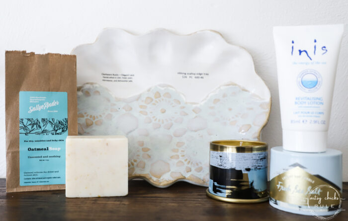 blue and white platter, lotion bottle, soap block and candle