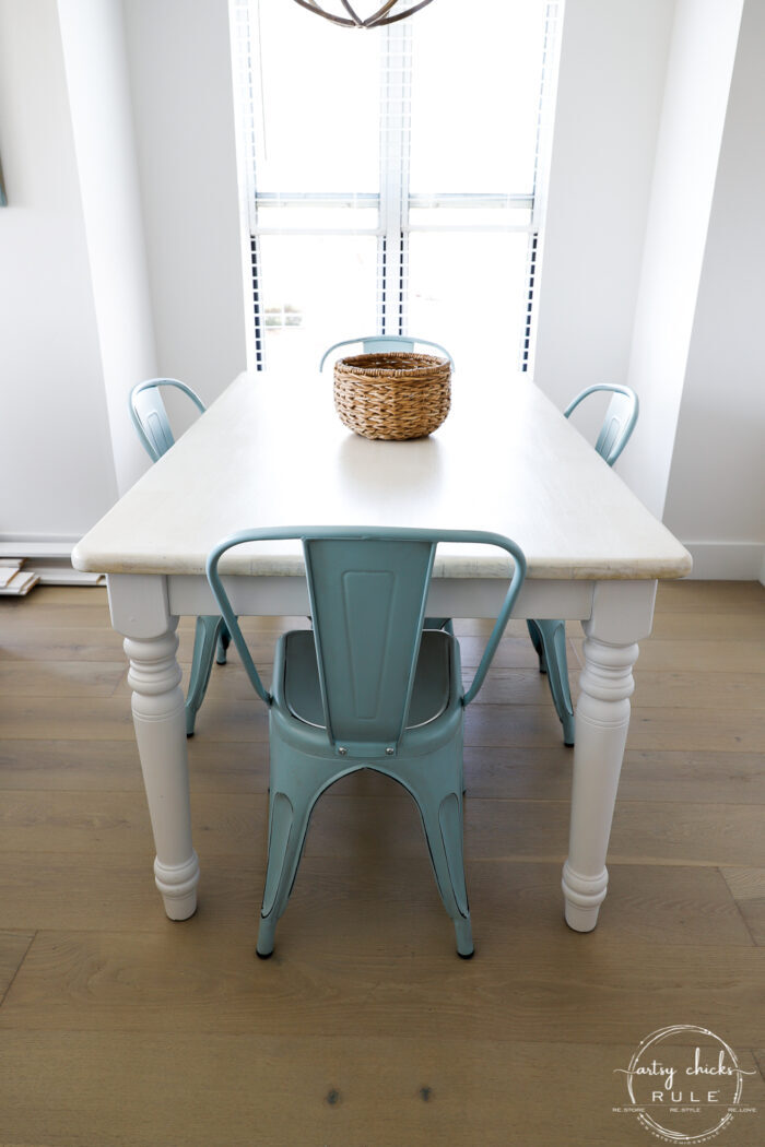 table and blue chairs