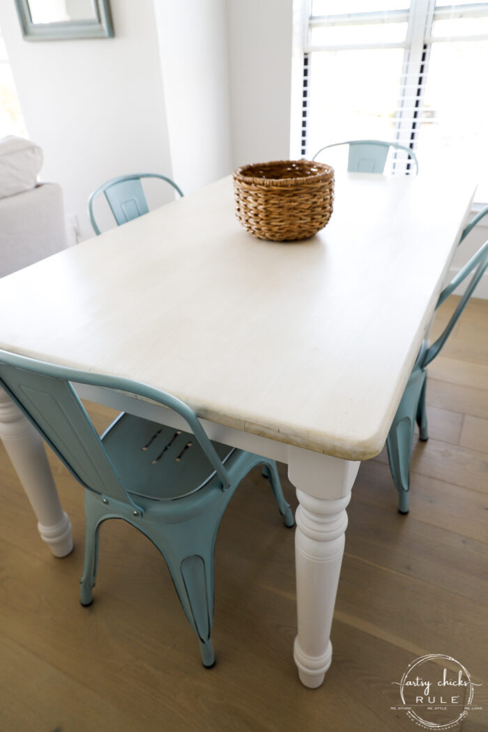 side view of table with blue chairs
